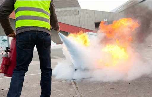 fire safety training with a fire extinguisher